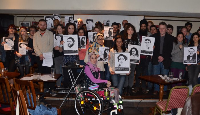 Participants at the Human Rights Film Festival at the University of York on 25 March 2015 hold up pictures of political prisoners and activists murdered by the Egyptian regime