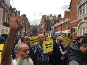 Protesters gather for a vigil at the Egyptian embassy, 21 June to protest the killing of Mohamed Morsi